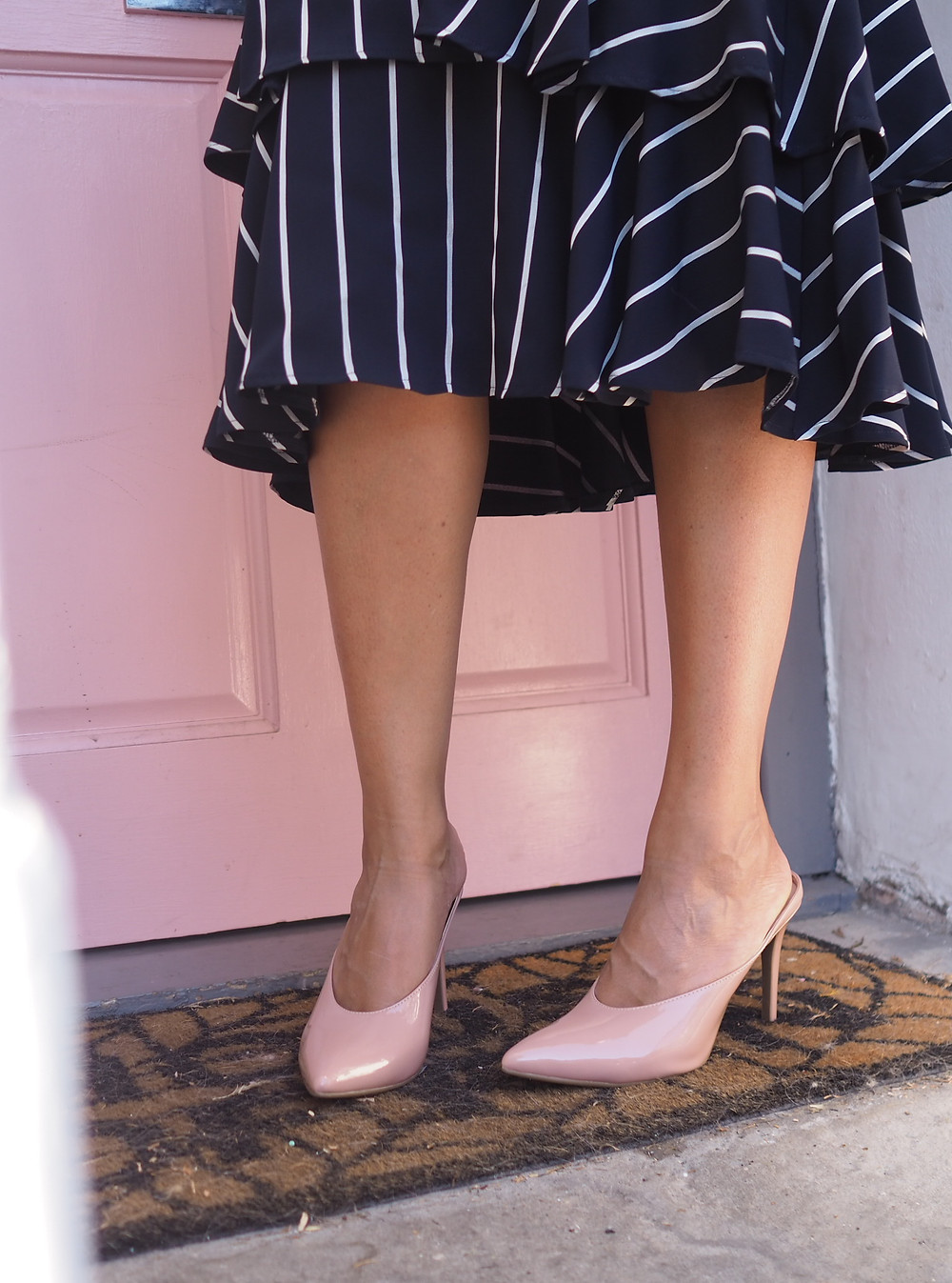 Nude high-heeled mules from Marks and Spencer, paired with a navy ad white striped tiered skirt.