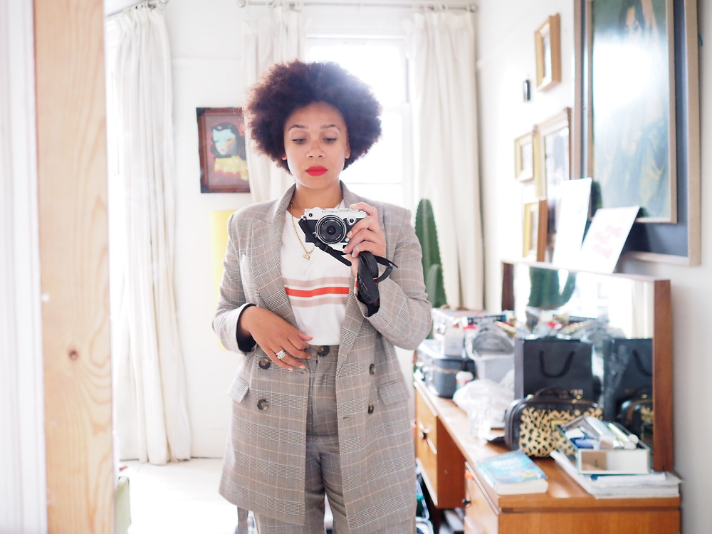 Natalie from Style Me Sunday wearing a checked M&S suit. Taking a photo with her camera looking in the mirror.