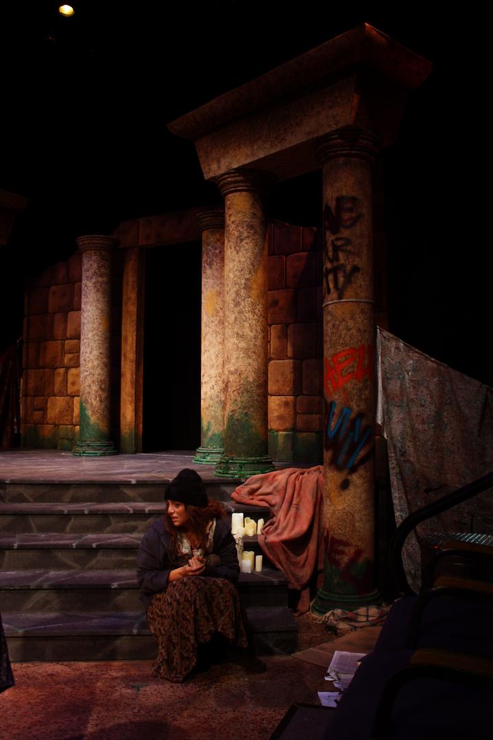 A Chorus Member Prays at the Palace Steps