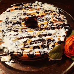 Sugar free lemon blueberry cream cake with vanilla frosting drizzle