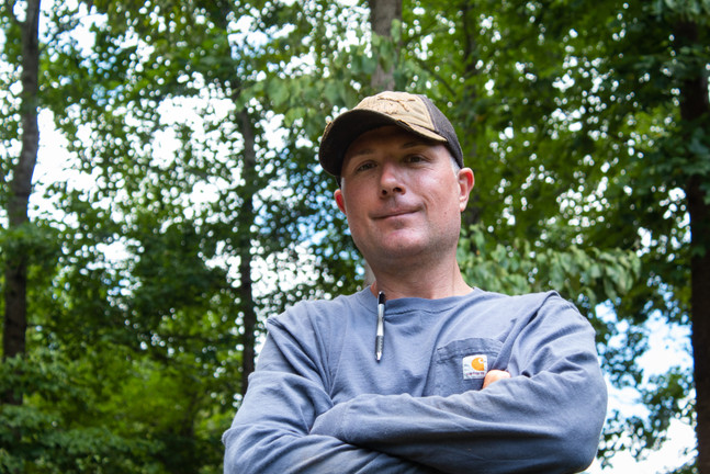 Michael posing in front of trees (0399).