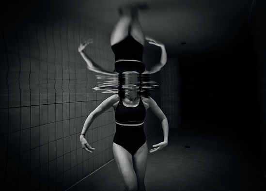 Strange Nature - person reflected in a swimming pool by Stefano Zocca