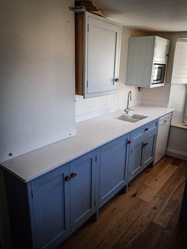 Bespoke Handmade Kitchen Blue with solid surface worktop
