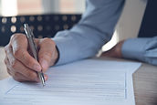 Close up of businessman with pen in hand