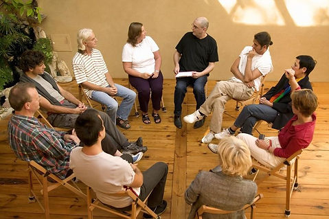 group therapy session sitting in a circle