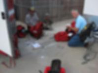 CERT volunteers checking their emergency preparedness backpacks.
