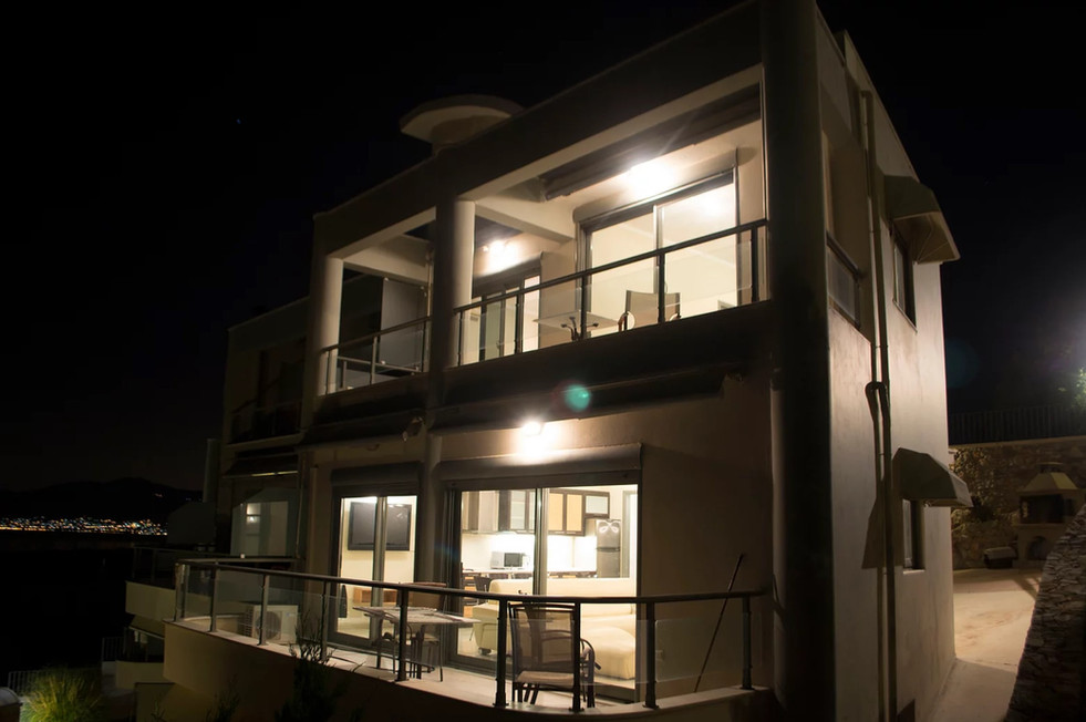 Night view of house for sale in Schinias beach, Athens