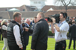 John Best Talks to the Media at the Races
