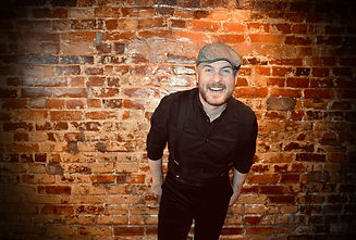 Luke James Shaffer, Smiling in front of a brick wall
