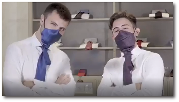 guys in mask ties arms crossed.png