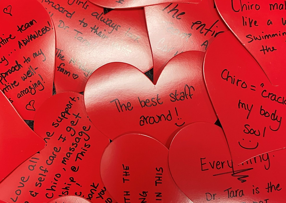 Kind words written on red paper hearts