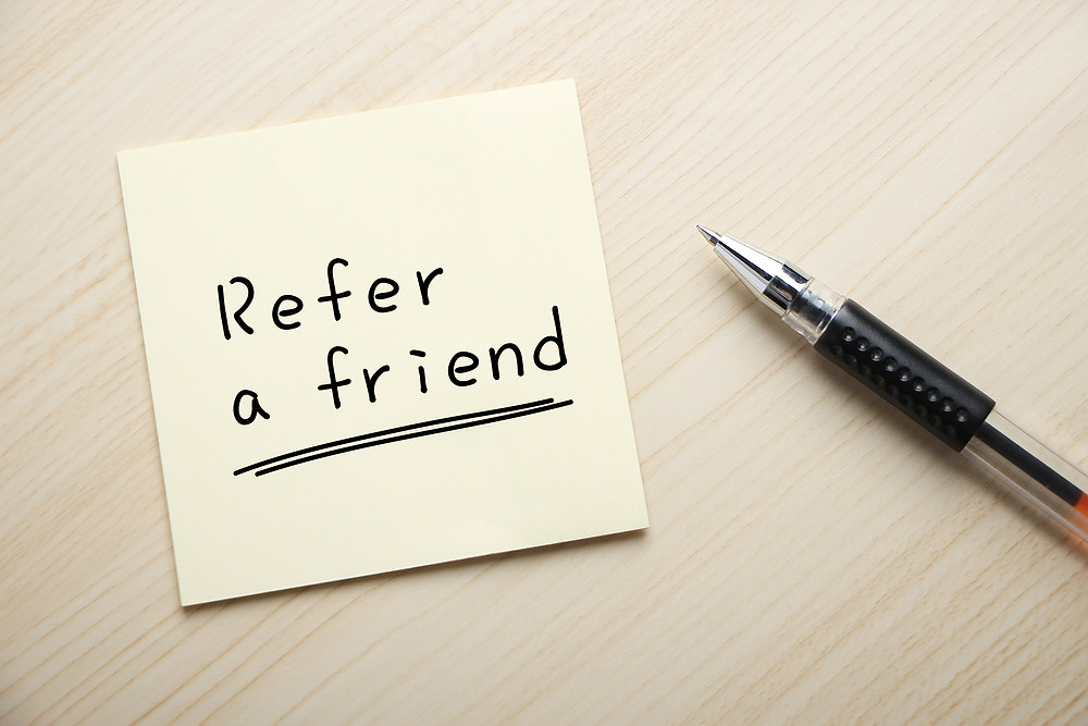 "Note saying ""refer a friend"""