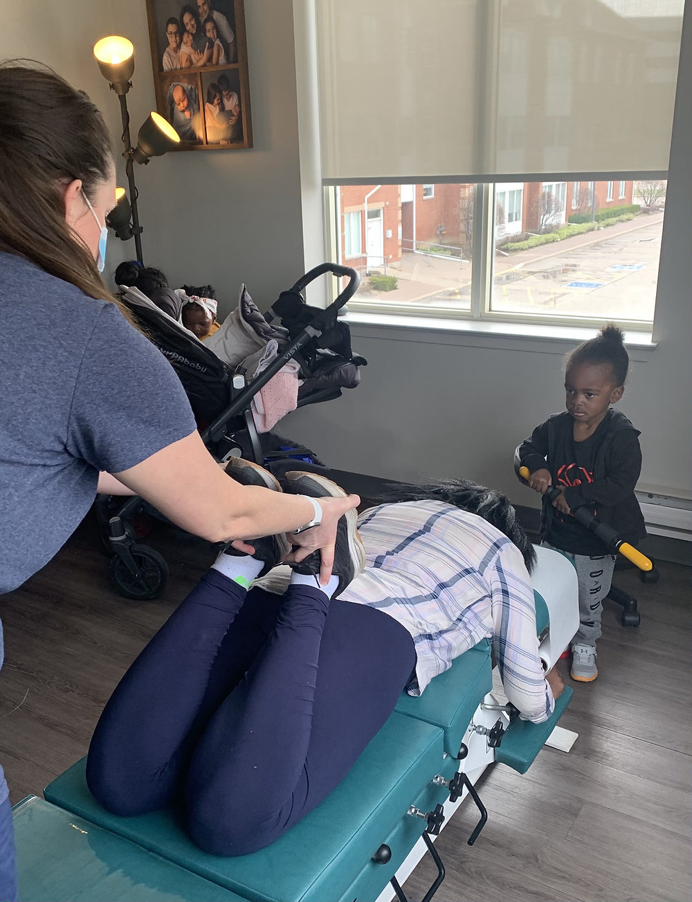 HIona gets adjusted with the gentle chiropractic Thompson Technique while her son watches