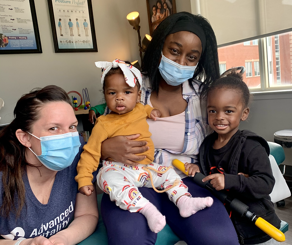 """Mother of the Week"" Hiona and her gorgeous children pose for a family photo with Dr. Tara Sutton after a chiropractic session at Advanced Vitality"