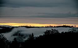 foggy canyon orange sky