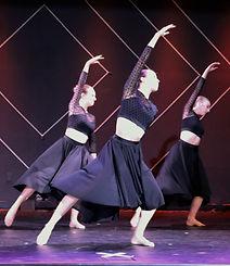 Contemporary ballet dancers in black