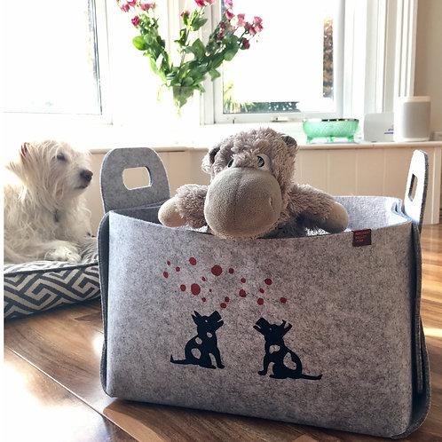 Two little dogs on a Felt Basket