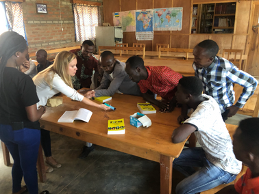 Providing refugees and migrants access to financial services via a mobile (non-smartphone) wallet