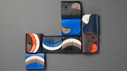 Two-faced leather goods