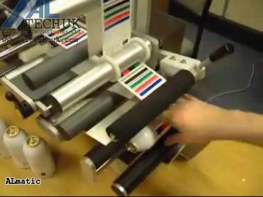ALTECH ALmatic - Semi Automatic Wraparound Labelling Aerosol Cannisters.mp4