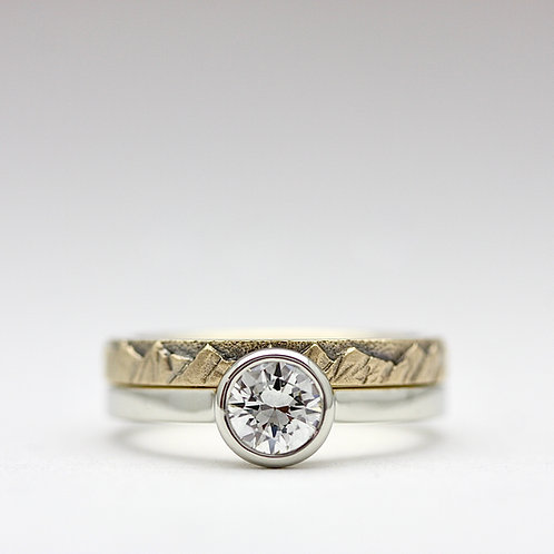Modern solitaire diamond ring w/ mountain stacking band