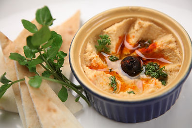 fresh-hummus-and-pita-bread-1618898.jpg