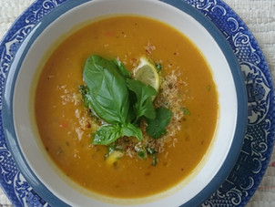 Autumn squash soup with toasted coconut and a fresh herb oil