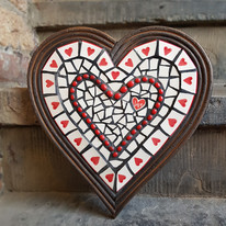Large mosaic heart created from a dinner plate