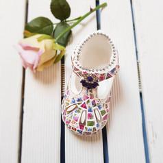 Baby shoe covered with china mosaic - beautiful keepsake