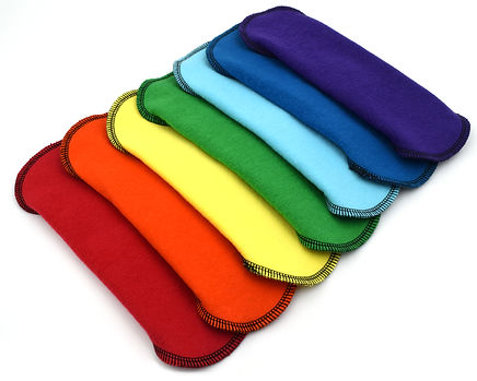folded DailyWings reuable cloth pads in rainbow colors