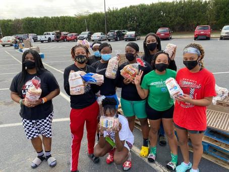 BHS Basketball Bravettes Volunteer in Their Community