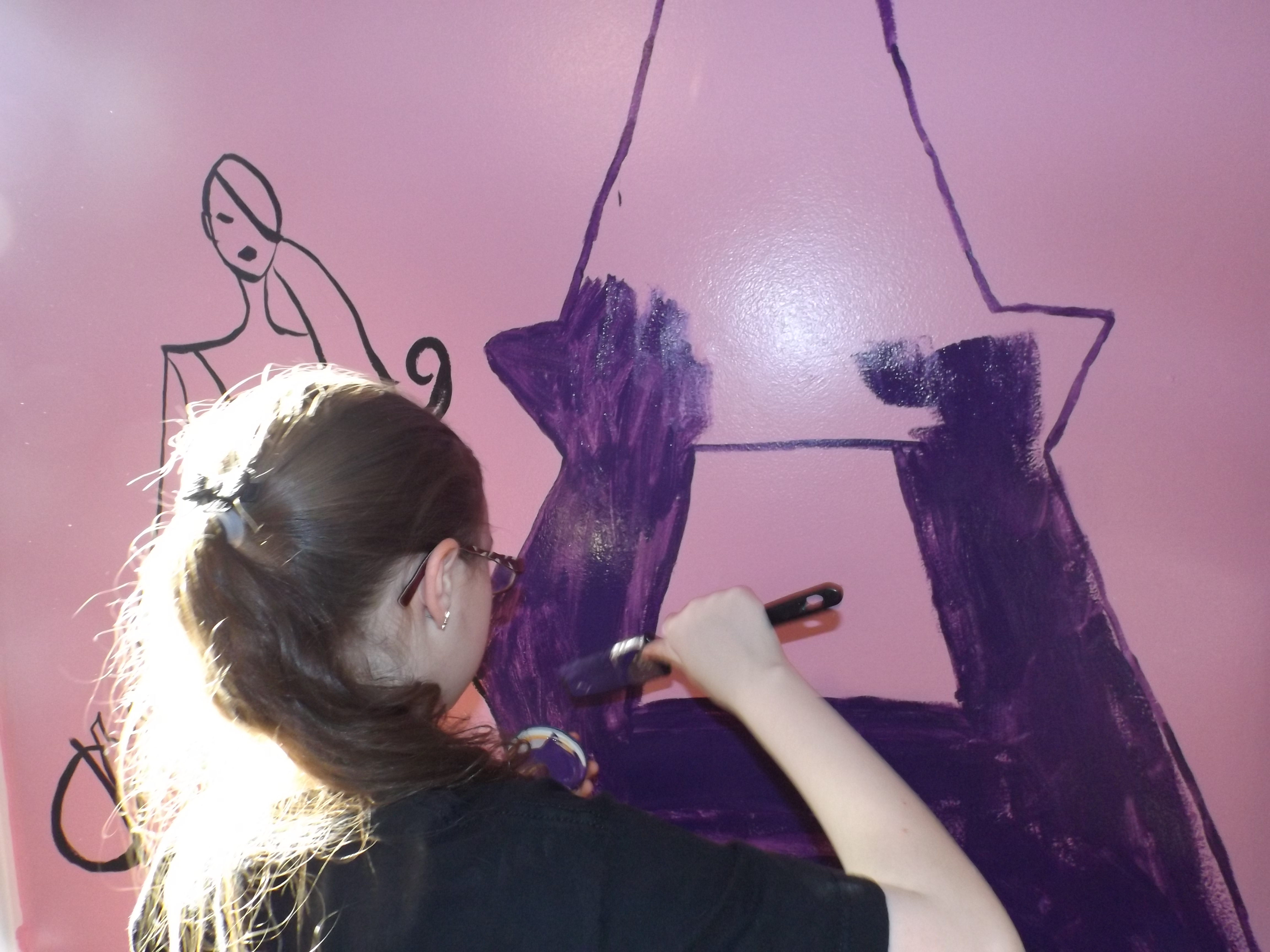 Erin paints the mural