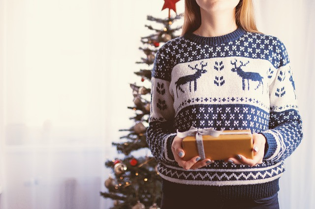 girl in sweater with gift