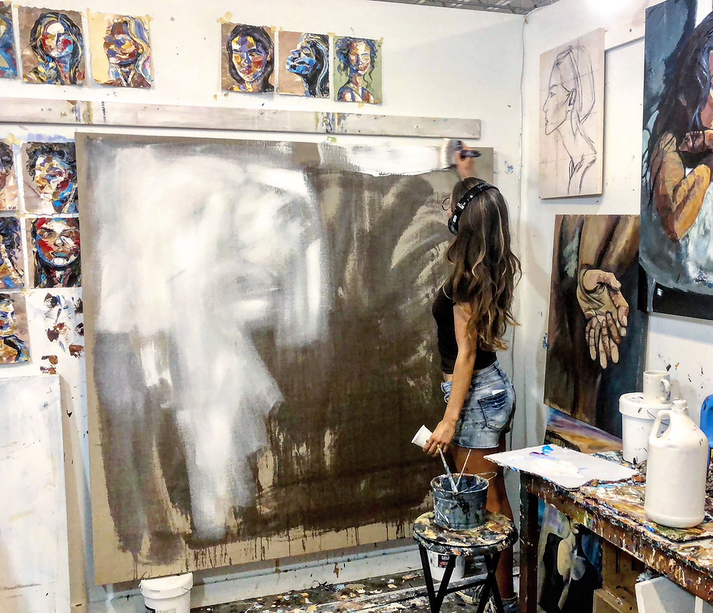 "two coats of gesso: priming the raw hand-stretched  66x66"" canvas"