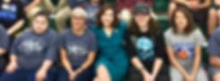 Joy Hofmeister sitting with students.