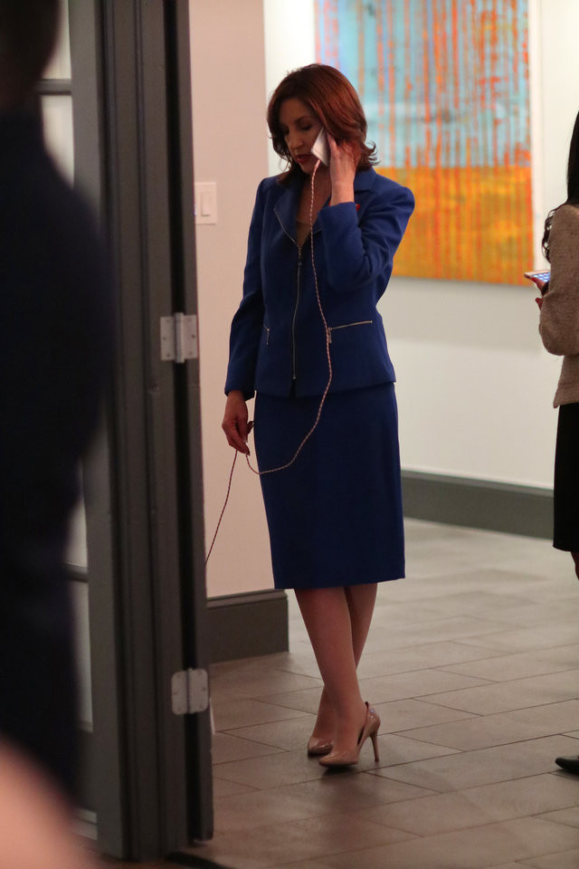 Joy Hofmeister, candidate for Oklahoma Schools Superintendent, talks on the phone in the hall where it's quiet, at her Republican runoff watch party.