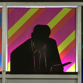 Detail from the facade wall. Cut out silhouette of a doctor. Black mount board, LED lights, designed and printed coloured vinyl sheets. 82.5 cm. x 80 cm.