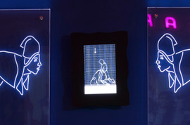 Tableau 13. Detail of edge-lit acrylic etched figures with LED screen playing a video in loop. Dimensions of frame with LED screen: 18 in. x 12.5 in.
