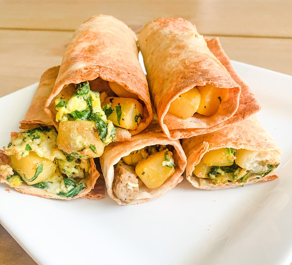 Rolled Breakfast Taquitos- Easy and Healthy Breakfast Idea in the Air fryer! I filled them with eggs potatoes and sausage!