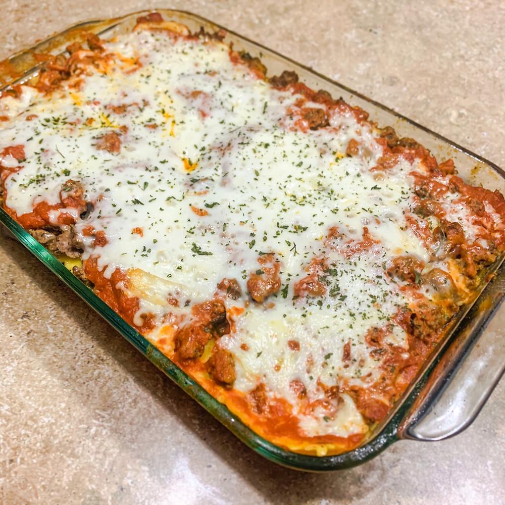 Ravioli lasagna layered with cheese ravioli, marinara sauce, ground beef, spinach and cheese
