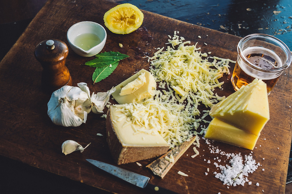 A collection of cheese for a great snack or dinner with some goose island craft beer