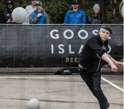 A Goose Island employee playing dodgeball
