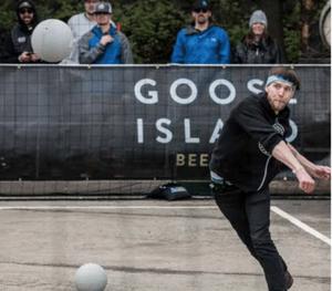 A Goose Island employee playing dodgeball