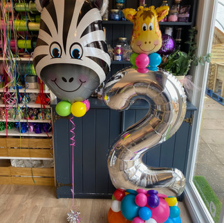 2nd birthday - zebra supershape with a large number 2 on a balloon base using matching rainbow latex and a small giraffe shape sitting on the top of the number