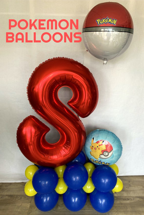 Number foil on a large base with themed foil and orb