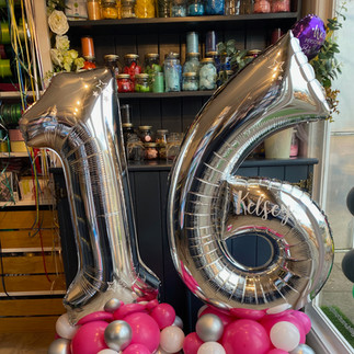 16th Birthday - Large silver numbers personalised on a pink, silver and white balloon base