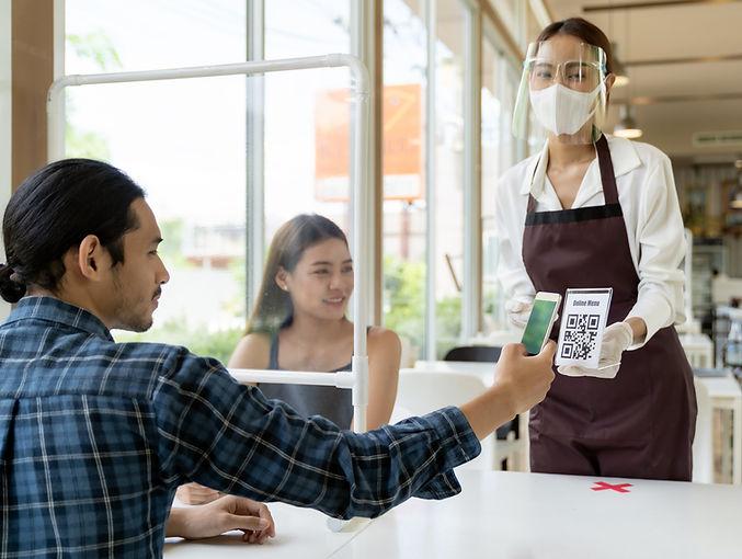 Asian customer scan QR code online menu
