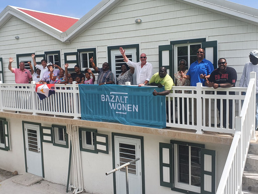 Four families move into restored St. John's homes