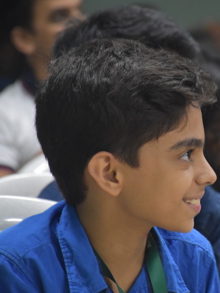 Adi, Student, Smiling, Looking Away from