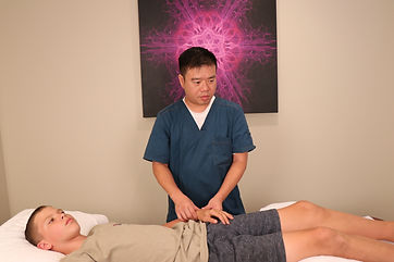 Dr. Jax Chou making sure the muscles are okay through touch, feel, Acupressure, and massages